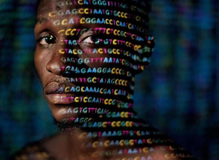 genetics-code-projected-face-african-man-crop.ngsversion.1520852522398.adapt.1900.1